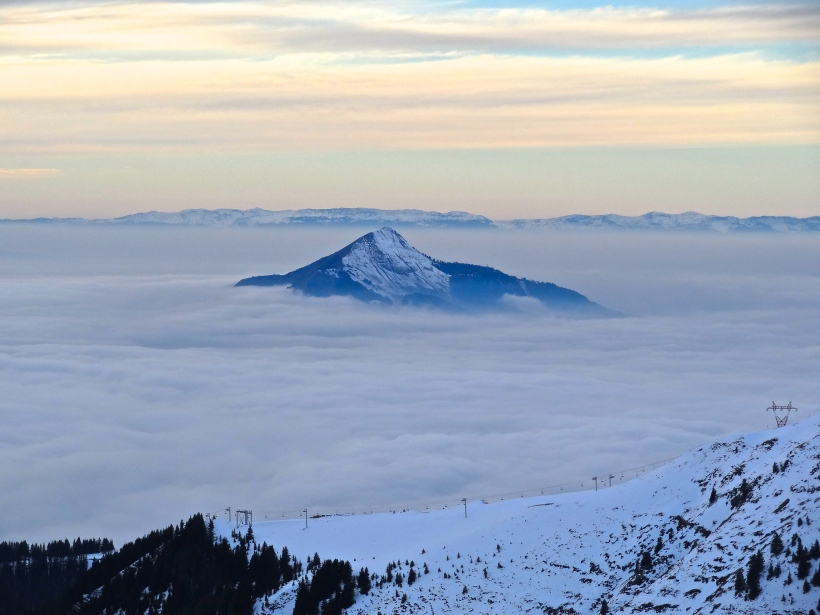 A lonely peak peers out through the cloud inversion