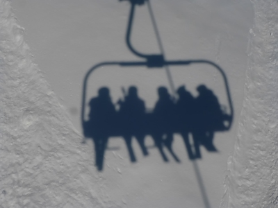 Happy skiers on the chair lift!