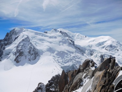 Majestic Mont Blanc with climbers in the foreground just finishing the Cosmiques Arête
